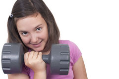 Teenage girl lifting weight Stock Image