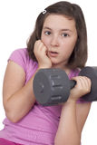 Teenage girl lifting weight Stock Photography