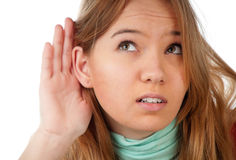 Teenage girl listening Stock Photos