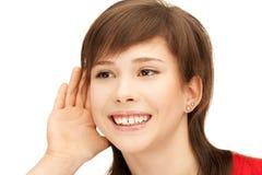 Teenage girl listening gossip Stock Photography