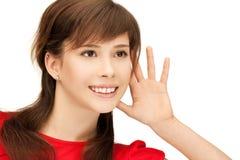Teenage girl listening gossip Stock Image