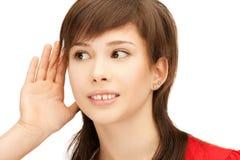 Teenage girl listening gossip Stock Photos