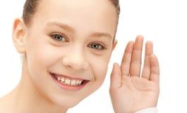 Teenage girl listening gossip Stock Photo