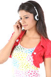 Teenage girl listening music. Happy teenage girl listening music Royalty Free Stock Photo