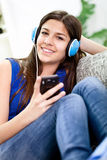 Teenage girl listening music Royalty Free Stock Photos