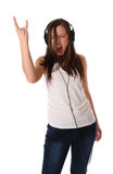 Teenage girl listening music on headphones Royalty Free Stock Photos