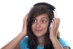 Teenage girl listening music with headphones Royalty Free Stock Images