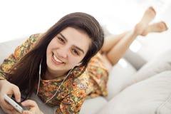 Teenage girl listening music through mobile phone Royalty Free Stock Images