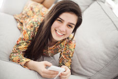 Teenage girl listening music through mobile phone Royalty Free Stock Image