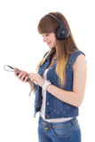 Teenage girl listening music with mobile phone isolated on white Royalty Free Stock Image