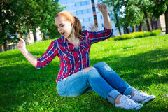 Teenage girl listening music in park Royalty Free Stock Image