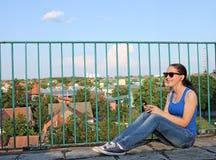 Teenage girl listening music on smart phone Stock Photo