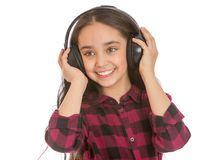 Teenage girl listening to big black headphones Stock Image