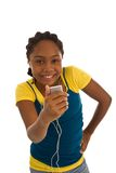 Teenage girl listening to her MP3 player Royalty Free Stock Photography