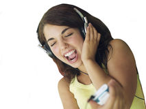 Teenage girl listening to MP3 player, singing, cut out Stock Images