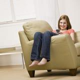 Teenage girl listening to mp3 player. Teenage girl sitting and listening to mp3 player Stock Photography