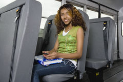 Teenage Girl Listening To MP3 Player On Bus royalty free stock image