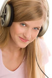 Teenage girl listening to music Stock Photos