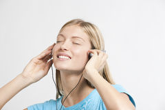 Teenage girl listening to the music. Isolated on white Royalty Free Stock Image