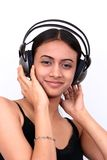 Teenage girl listening to music. Stock Images