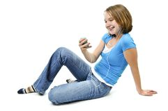 Teenage girl listening to music Royalty Free Stock Photo