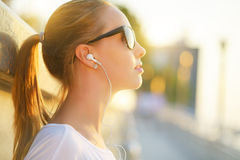 Teenage girl listening to music Stock Images