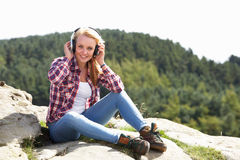 Teenage Girl Listening To Music In Countryside Royalty Free Stock Photos