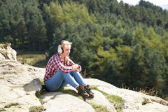 Teenage Girl Listening To Music In Countryside Stock Photos