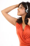 Teenage girl listening to music with earphones Royalty Free Stock Photography