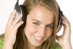 Teenage Girl Listening To Music On Headphones Stock Image