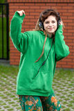 Teenage girl listening to music in headphones. Teenage girl dancing and listening to music in headphones Royalty Free Stock Photography