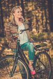 Teenage girl listens music on a bicycle outdoors Royalty Free Stock Photos
