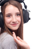 Teenage girl listens to music Stock Photo