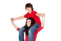 Teenage girl with little boy on her shoulders Stock Images
