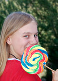 teenage Girl with lollipop Stock Photos