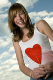 Teenage girl with lollipop Stock Images