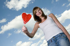 Teenage girl with lollipop Royalty Free Stock Photo