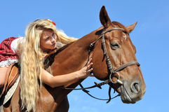 Teenage  girl with long hair horseback riding Stock Photography