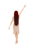 Teenage girl with long hair pointing up and down Stock Photography