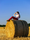 Teenage girl with long hair posing in summer field, countryside Stock Images