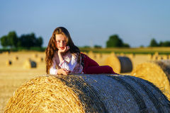 Teenage girl with long hair posing in summer field, countryside Royalty Free Stock Photography