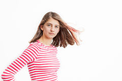 Teenage Girl with long hair and white pink striped shirt Stock Image