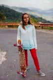 Teenage girl with longboard Royalty Free Stock Photos