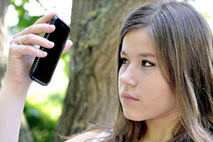 Teenage Girl Looking At Mobile Cell Phone Stock Photos