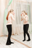 Teenage girl looking at the mirror Stock Photo