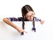 Teenage girl looking on board Stock Photo