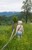 Teenage girl looking into the distance in the mountains Stock Photo