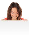 Teenage girl looking down blank sign Royalty Free Stock Image