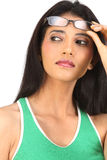 teenage girl looking with eyeglasses Stock Photo