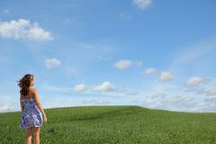 Teenage girl looking into natural landscape Stock Image